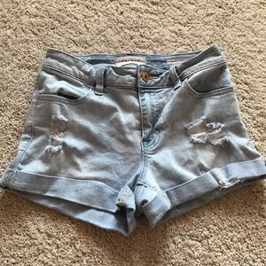 Slightly ripped denim shorts